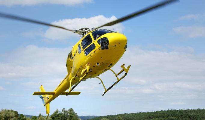 Rundflug Gelber Hubschrauber