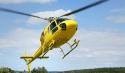 Gelber Hubschrauber startet